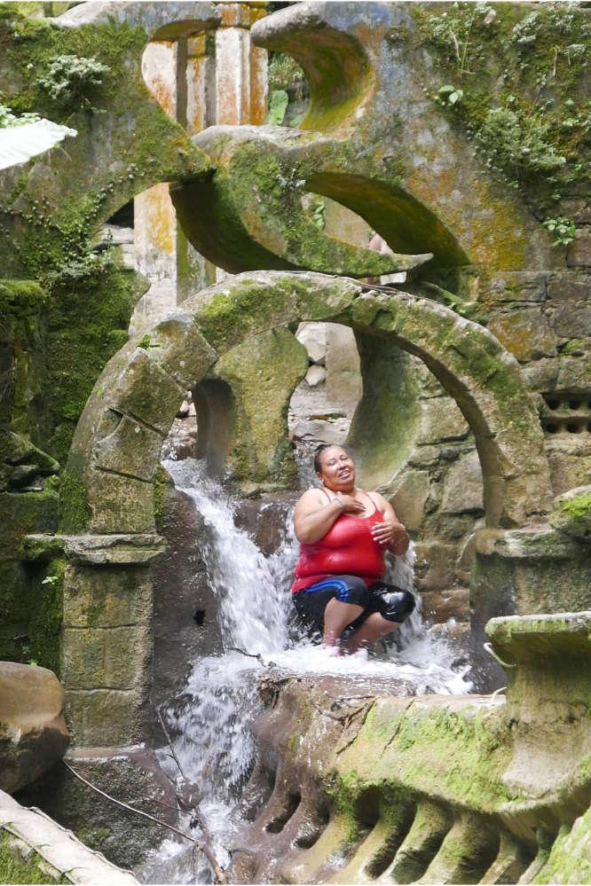 Woman bathing in Las Pozas surrealist garden in Xilitla