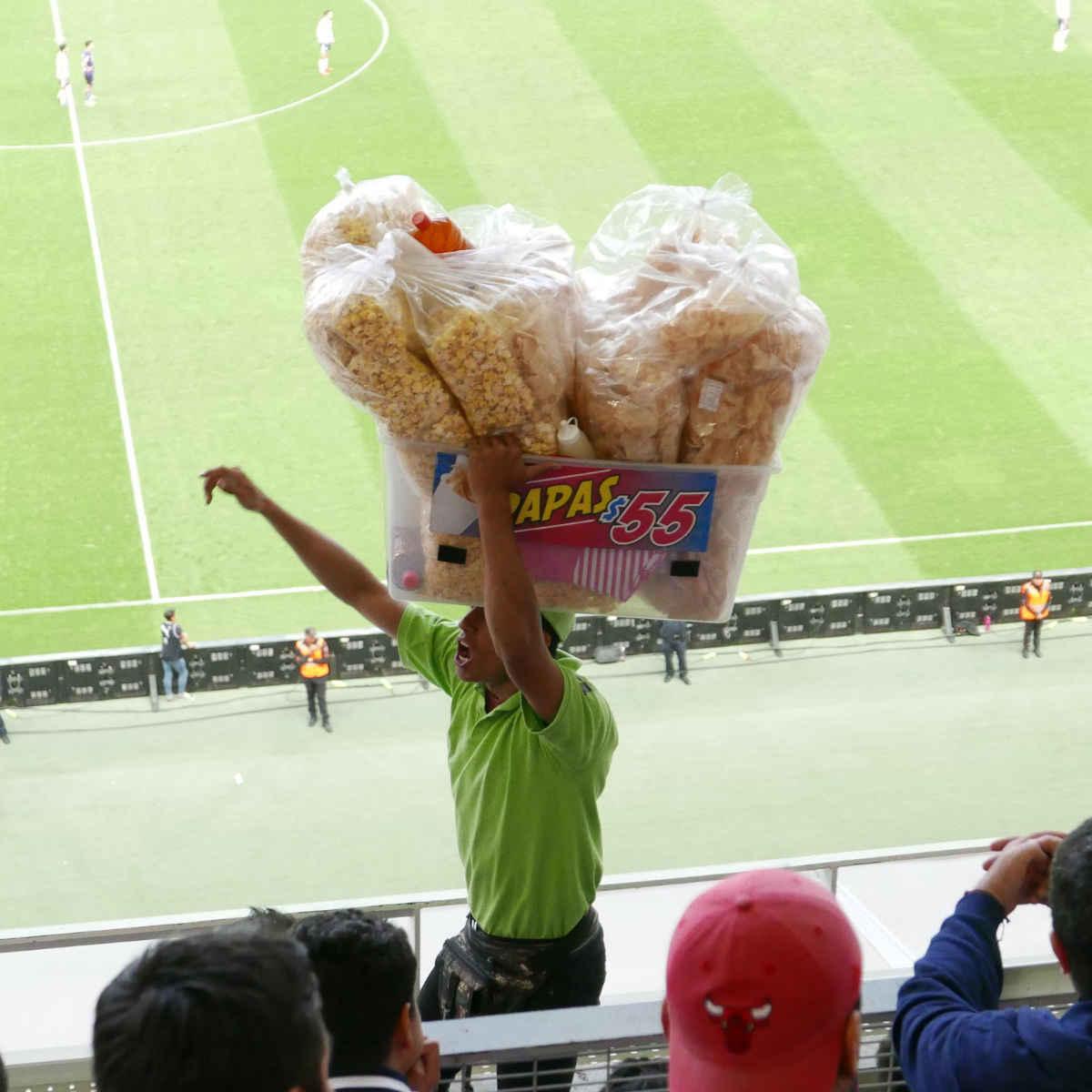 Catering employee selling snacks inside Chivas stadium in Guadalajara