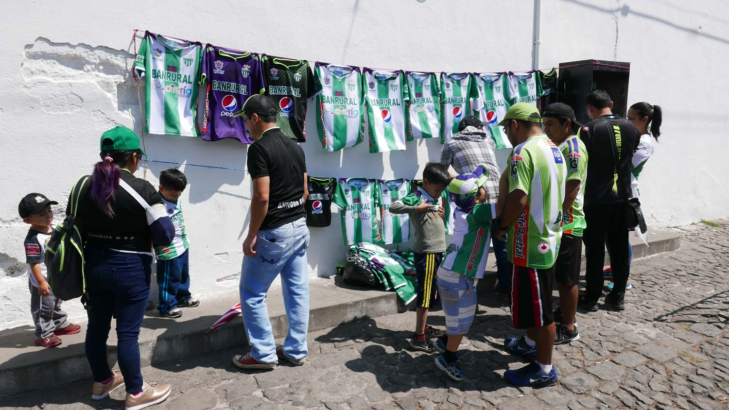Selling shirts of the local club in Antigua Guatemala