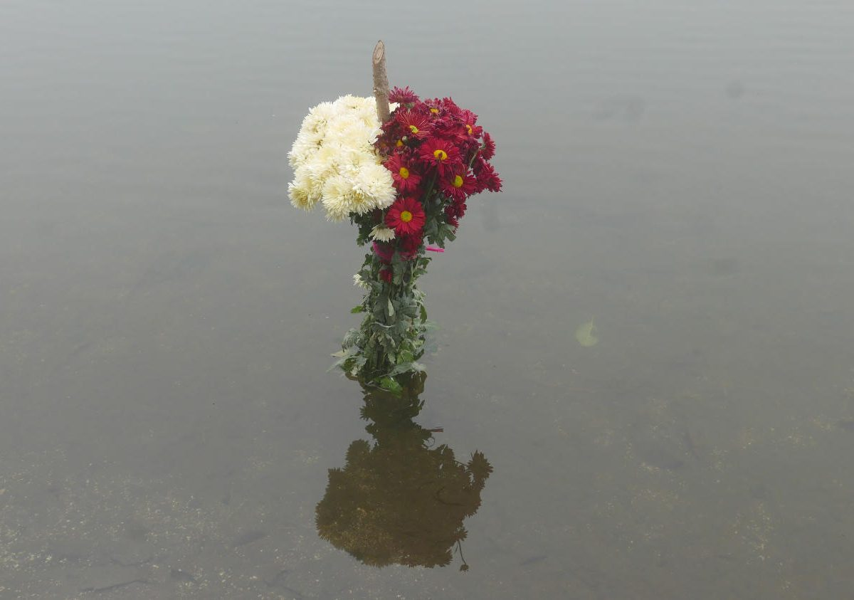 Flower sacrifice in Lake Chicabal