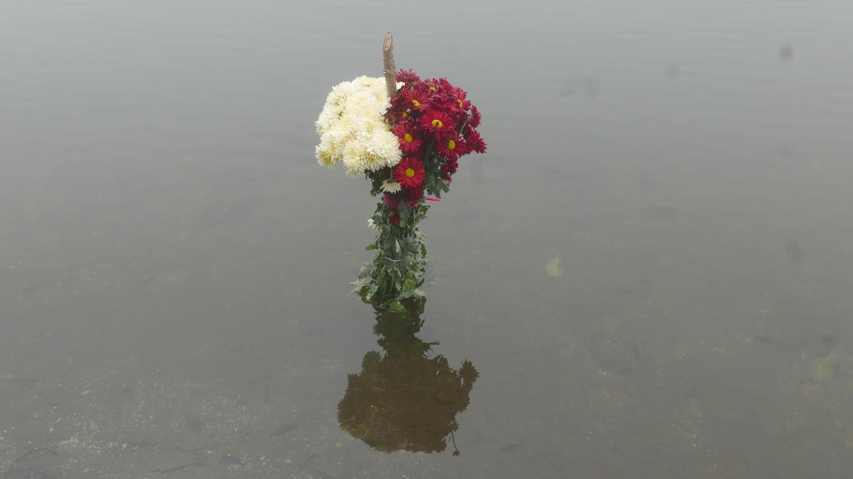 Flower sacrifice in Lake Chicabal