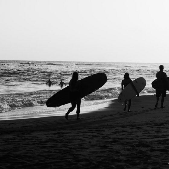 Surfers at El Sunzal beach, El Tunco village, El Salvador
