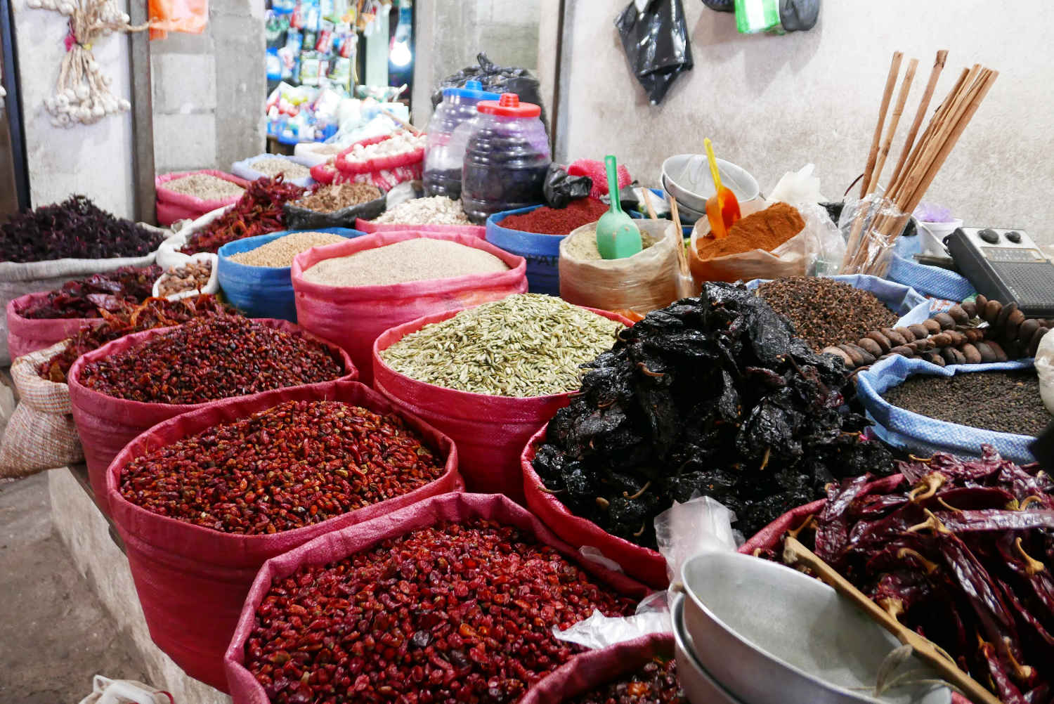 Spices and ingredients (coffee in red!) in Minerva market in Xela