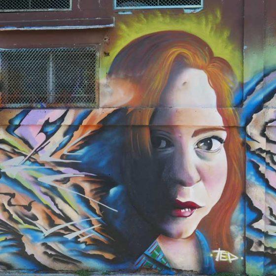 Shrewd woman. Street art in San Jose, Costa Rica