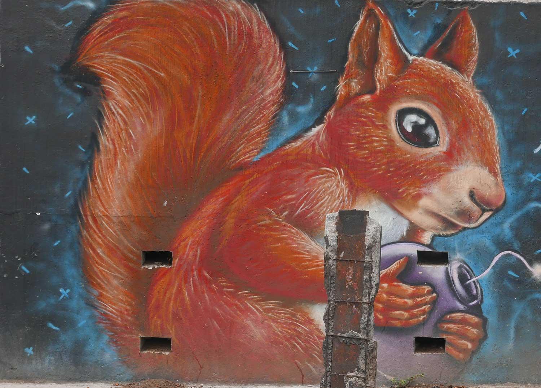 Spraying squirrel. Street art in San Jose, Costa Rica