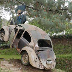Crashed Volkswagen Beetle as a sculpture at Santo Domingo de Cerros near Antigua