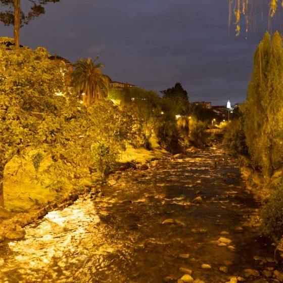 Tomebamba river by night in Cuenca
