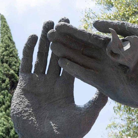 Reaching Hands artwork Puebla